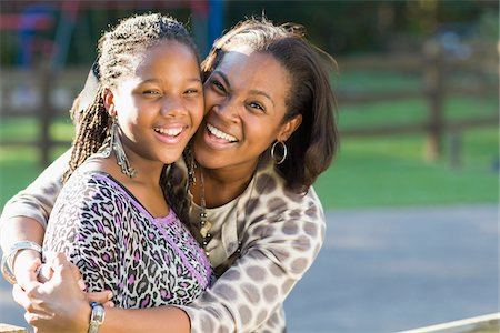 Portrait of pre-teen girl and mother, hugging outdoors Stock Photo - Premium Royalty-Free, Code: 600-06847435