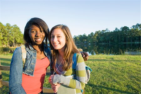 female only - Portrait of pre-teen girls smiling and looking at camera, outdoors Stock Photo - Premium Royalty-Free, Code: 600-06847445