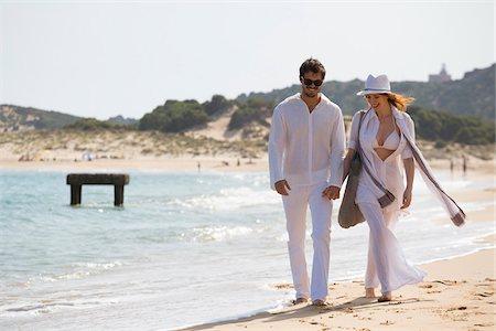 Young couple walking at the beach during summer holidays, Cala Cipolla, Chia Bay, Sardinia, Italy Stock Photo - Premium Royalty-Free, Code: 600-06841644