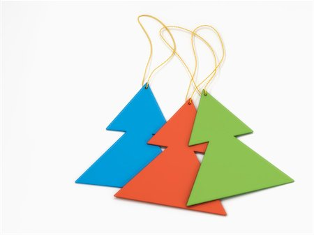 Three Christmas tree shaped decorations on white background Stock Photo - Premium Royalty-Free, Code: 600-06841665