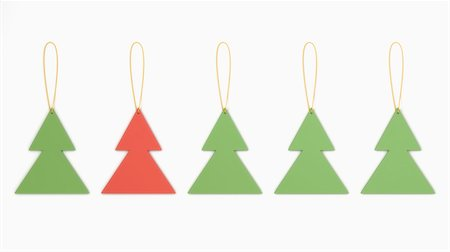 Christmas tree shaped decorations in a row on white background Stock Photo - Premium Royalty-Free, Code: 600-06841666