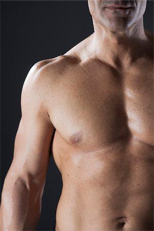 Close-up of Muscular Man's Chest, Studio Shot Stock Photo - Premium Royalty-Free, Code: 600-06841740