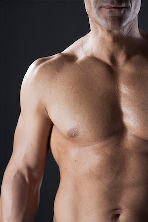 Close-up of Muscular Man's Chest, Studio Shot Stock Photo - Premium Royalty-Free, Code: 600-06841740