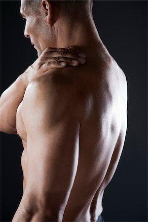 Close-up of Man's Back, Studio Shot Stock Photo - Premium Royalty-Free, Code: 600-06841743