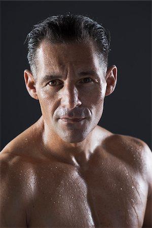 Portrait of Man Sweating, Studio Shot Stock Photo - Premium Royalty-Free, Code: 600-06841764