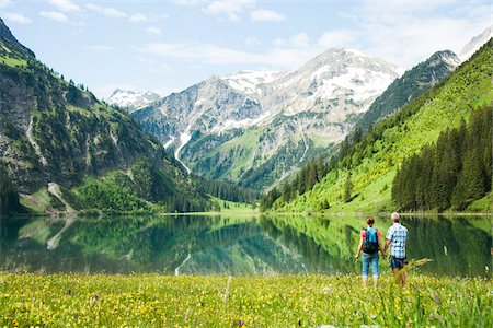 Couple Hiking by Lake, Vilsalpsee, Tannheim Valley, Tyrol, Austria Stock Photo - Premium Royalty-Free, Code: 600-06841774