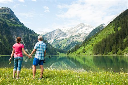 Couple Hiking by Lake, Vilsalpsee, Tannheim Valley, Tyrol, Austria Stock Photo - Premium Royalty-Free, Code: 600-06841776