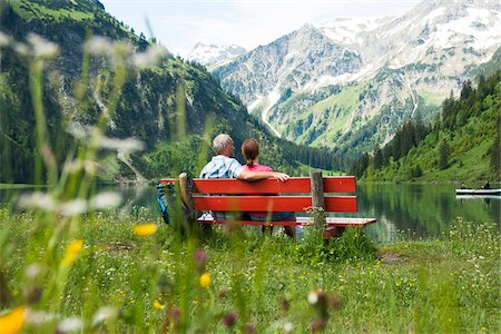 people sitting on bench - Couple Sitting on Bench by Lake, Vilsalpsee, Tannheim Valley, Tyrol, Austria Stock Photo - Premium Royalty-Free, Code: 600-06841777
