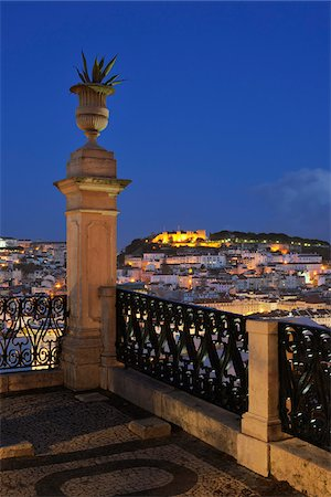 portugal - Castelo de Sao Jorge Illuminated at Night seen from Sao Pedro de Alcantara, Lisbon, Portugal Stock Photo - Premium Royalty-Free, Code: 600-06841817