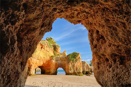 extreme terrain - Natural Arch Rock Formations at Praia dos Tres Irmaos, Alvor, Portimao, Algarve, Portugal Stock Photo - Premium Royalty-Free, Code: 600-06841821