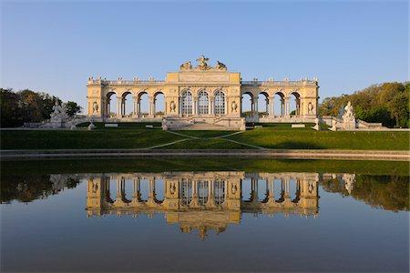Gloriette reflected in Pond in Garden at Schonbrunn Palace, Vienna, Austria Stock Photo - Premium Royalty-Free, Code: 600-06841851