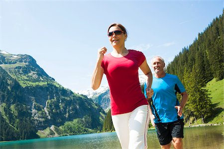 Mature man and woman power walking, Lake Vilsalpsee, Tannheim Valley, Austria Stock Photo - Premium Royalty-Free, Code: 600-06841898