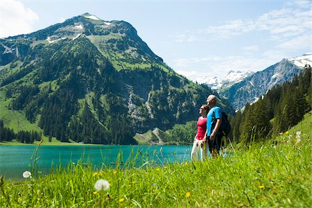scenic view - Mature man and woman looking at scenic view, Lake Vilsalpsee, Tannheim Valley, Austria Stock Photo - Premium Royalty-Free, Code: 600-06841900