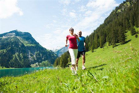 Mature man and woman power walking, Lake Vilsalpsee, Tannheim Valley, Austria Stock Photo - Premium Royalty-Free, Code: 600-06841901