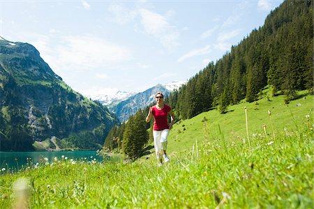 Mature woman power walking, Lake Vilsalpsee, Tannheim Valley, Austria Stock Photo - Premium Royalty-Free, Code: 600-06841902