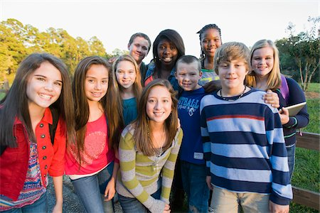 Group portrait of pre-teens standing outdoors, smiling and looking at camera, Florida, USA Stock Photo - Premium Royalty-Free, Code: 600-06841925