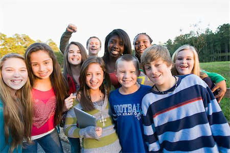 Group portrait of pre-teens standing outdoors, smiling and looking at camera, Florida, USA Stock Photo - Premium Royalty-Free, Code: 600-06841926