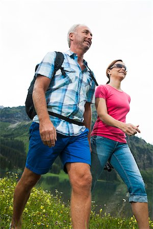 female hiking - Close-up of mature couple hiking in mountains, Lake Vilsalpsee, Tannheim Valley, Austria Stock Photo - Premium Royalty-Free, Code: 600-06841946