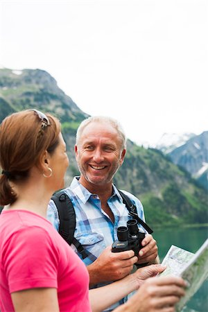 Close-up of mature couple looking at map, hiking in mountains, Lake Vilsalpsee, Tannheim Valley, Austria Stock Photo - Premium Royalty-Free, Code: 600-06841943