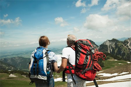 Backview of mature couple looking at map, hiking in mountains, Tannheim Valley, Austria Stock Photo - Premium Royalty-Free, Code: 600-06841955