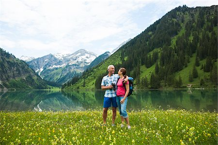 Mature couple hiking in mountains, Lake Vilsalpsee, Tannheim Valley, Austria Stock Photo - Premium Royalty-Free, Code: 600-06841950