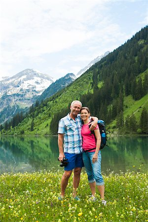 Portrait of mature couple hiking in mountains, Lake Vilsalpsee, Tannheim Valley, Austria Foto de stock - Royalty Free Premium, Número: 600-06841951