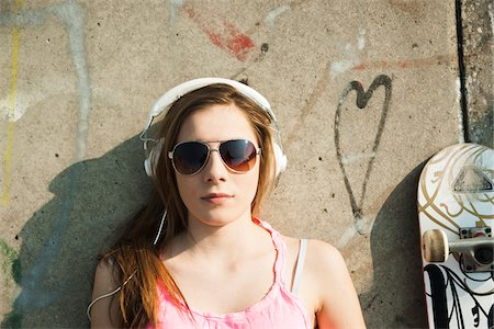 female only - Teenager wearing Headphones in Skatepark, Feudenheim, Mannheim, Baden-Wurttemberg, Germany Stock Photo - Premium Royalty-Free, Code: 600-06894838