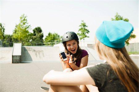 Girls in Skatepark with Smartphone, Feudenheim, Mannheim, Baden-Wurttemberg, Germany Stock Photo - Premium Royalty-Free, Code: 600-06894855
