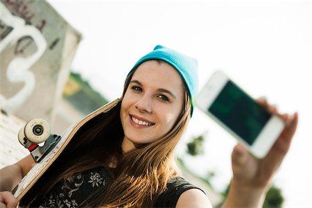 Teenage Girl taking Self Portrait in Skatepark, Feudenheim, Mannheim, Baden-Wurttemberg, Germany Stock Photo - Premium Royalty-Free, Code: 600-06894858
