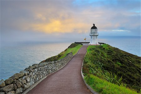 Cape Reinga Lighthouse at Dawn, Cape Reinga, Northland, North Island, New Zealand Stock Photo - Premium Royalty-Free, Code: 600-06894929