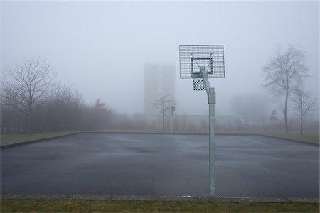 Basketball Court on Misty Morning, Kastrup, Copenhagen, Denmark Stock Photo - Premium Royalty-Free, Code: 600-06895014