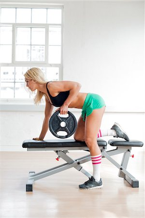 Woman Lifting Weight on Bench in Fitness Studio, Copenhagen, Denmark Stock Photo - Premium Royalty-Free, Code: 600-06895028