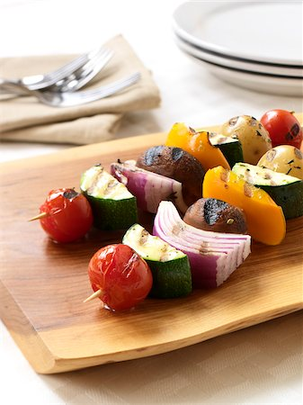 2 BBQ'd Veggie Kebabs on a cutting board ready to be served Stock Photo - Premium Royalty-Free, Code: 600-06895075