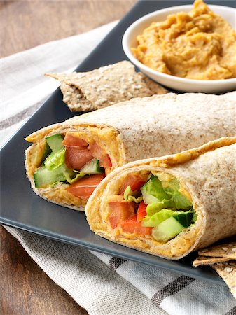 Vegetarian Hummus Wraps Served on Platter with Hummus Dip and Crackers Stock Photo - Premium Royalty-Free, Code: 600-06895072