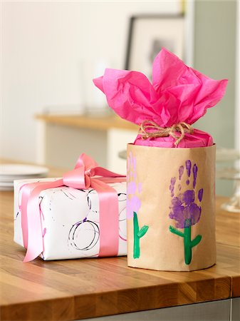 festive - Presents Wrapped using Homemade Wrapping Paper made with Kid's Crafts Stock Photo - Premium Royalty-Free, Code: 600-06895083