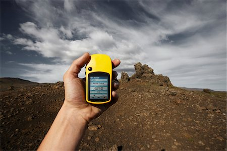 Hand Holding Yellow GPS Navigator, Reykjanes, Iceland Stock Photo - Premium Royalty-Free, Code: 600-06899686
