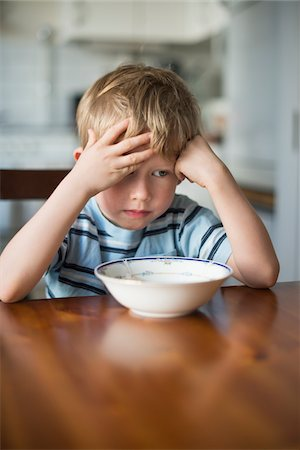 Young Boy with Hand on Head waiting for Breakfast at Kitchen Table, Copenhagen, Denmark Stock Photo - Premium Royalty-Free, Code: 600-06899694
