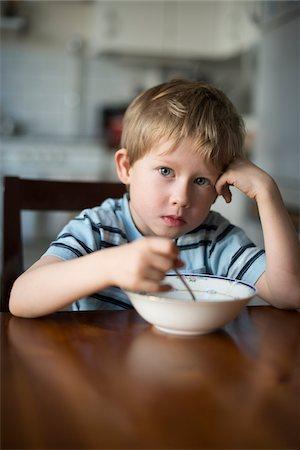 Young Boy eating Breakfast at Kitchen Table, Copenhagen, Denmark Stock Photo - Premium Royalty-Free, Code: 600-06899693