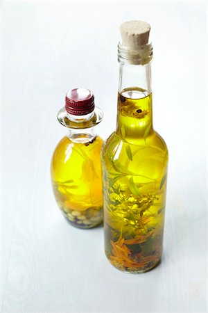 Still life of bottles of olive oil with herbs, Germany Stock Photo - Premium Royalty-Free, Code: 600-06899771
