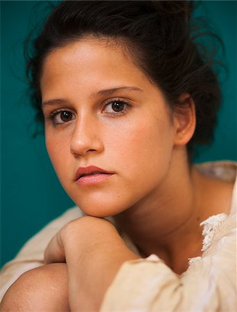 Close-up, portrait of teenaged girl, looking at camera Stock Photo - Premium Royalty-Free, Code: 600-06899819
