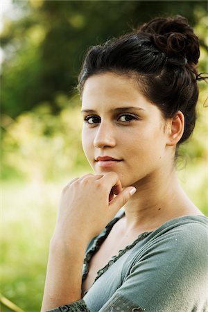 Close-up portrait of teenaged girl outdoors in nature, looking at camera, Germany Stock Photo - Premium Royalty-Free, Code: 600-06899840