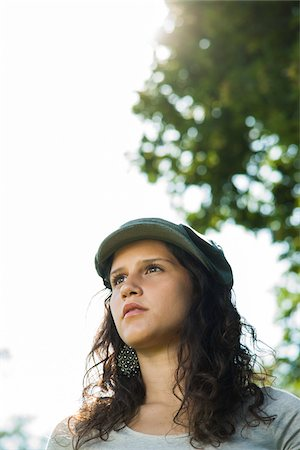portrait looking away - Close-up portrait of teenaged girl wearing cap outdoors, looking into the distance, Germany Stock Photo - Premium Royalty-Free, Code: 600-06899853
