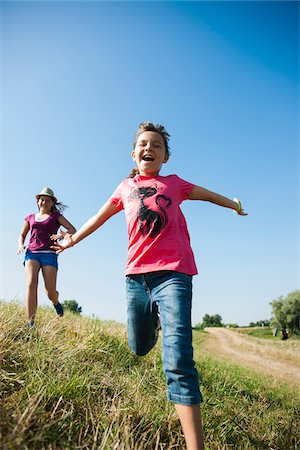 preteen open mouth - Girls running in field, Germany Stock Photo - Premium Royalty-Free, Code: 600-06899867