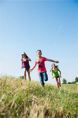 Girls running in field, Germany Stock Photo - Premium Royalty-Free, Code: 600-06899868