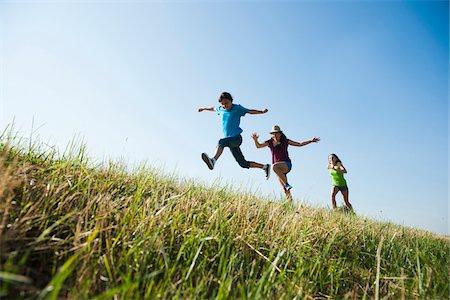 Girls running up hill, Germany Stock Photo - Premium Royalty-Free, Code: 600-06899860