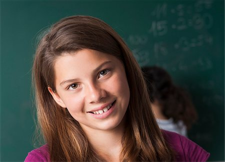 preteen  smile  one  alone - Close-up portrait of girl in classroom, Germany Stock Photo - Premium Royalty-Free, Code: 600-06899889