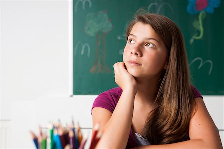 school desk - Teenaged girl sitting at desk in classroom, Germany Stock Photo - Premium Royalty-Free, Code: 600-06899897