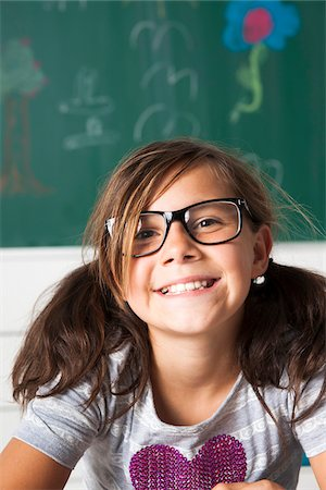Close-up portrait of girl sitting at desk in classroom, Germany Stock Photo - Premium Royalty-Free, Code: 600-06899898