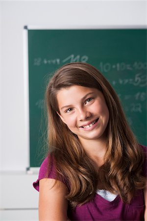 preteen  smile  one  alone - Portrait of girl in classroom, Germany Stock Photo - Premium Royalty-Free, Code: 600-06899890