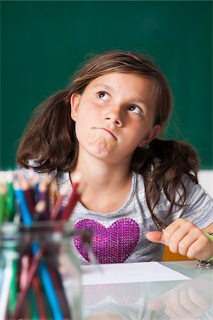 preteen girl pigtails - Portrait of girl sitting at desk in classroom, Germany Stock Photo - Premium Royalty-Free, Code: 600-06899891